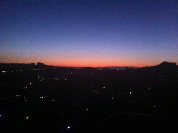 sun behind the hills